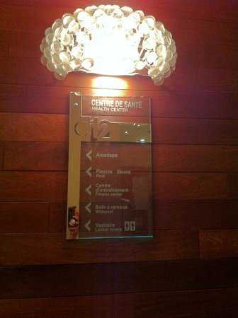 "Hotel Le Crystal: The elevator signs with ""crystal"" light fixture."