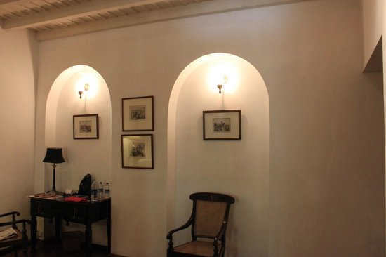 Neemrana's Le Colonial: Desk and colonial pictures in our room.