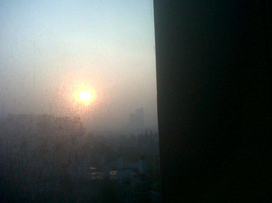 Gran Melia Jakarta: View from the room - sunrise in Jakarta