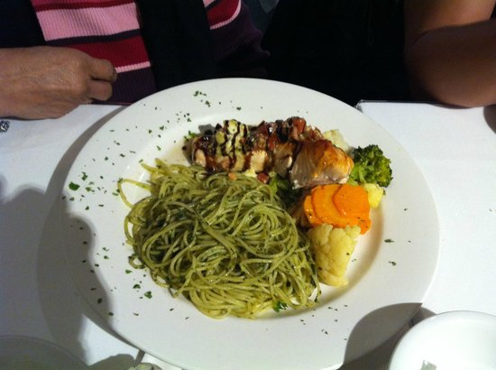 Spag & Tini: Salmon fillet with pesto pasta and vegetables.
