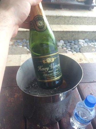 Sandals Regency La Toc Golf Resort and Spa: Javan helped us celebrate with some champagne