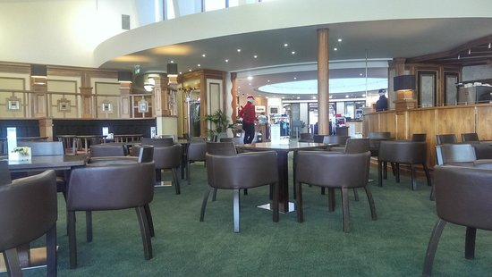 The Castle Course at St. Andrews Links: The lounge and looking through to the shop and entrance doors.