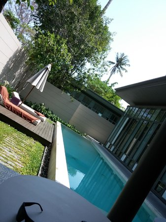 SALA Phuket Resort & Spa: View of the pool and sun loungers from the outdoors seating area ;-)