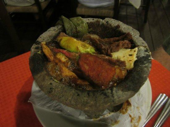 "La Destileria : husbands Steak and Chicken ""Molcajete""-stayed hot entire time"