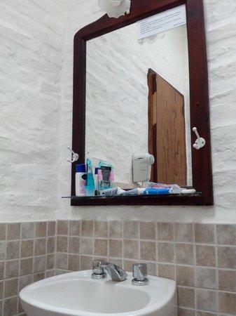 Posada Pecos: Espejo de baño