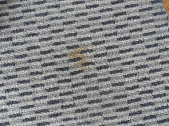 Hilton London Wembley: Noticeable stain on the carpet