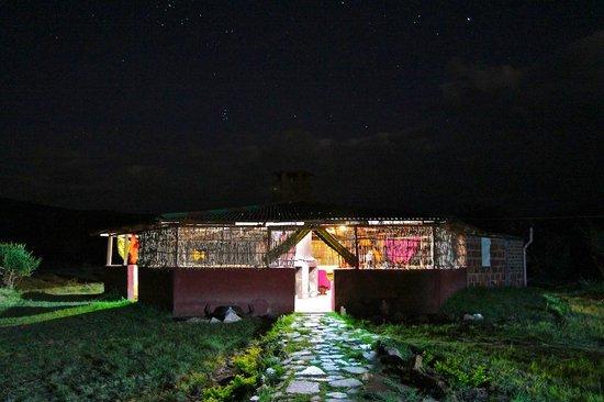 Leganishu Maasai Cultural Homestay: The common area at night