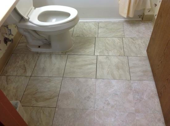 Days Inn & Suites Lafayette IN: mismatched patched floor