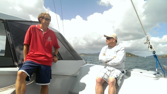 Carino Sailing & Dolphins: Todd getting a lesson on dolphin behavior