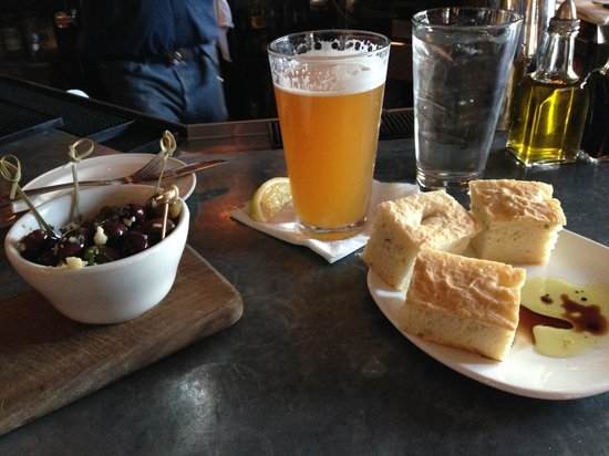 Pescatore: $2 happy hour olives, Pyramid here, bread