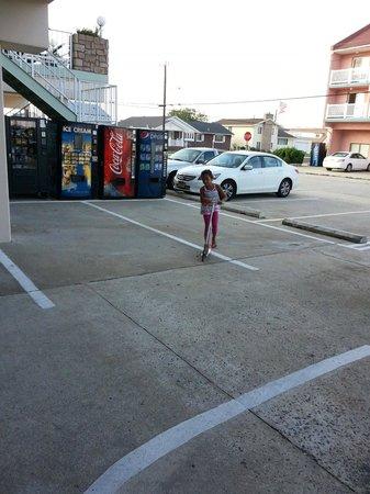 Acacia Beachfront Resort: parking and play area at acacia