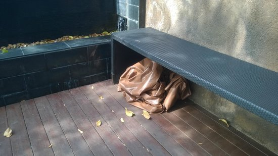 Paresa Resort Phuket : Cover stuffed under a bench by the main pool