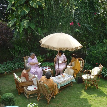 Prabhakar Homestay : Mrs. Bora (in pink) on the lawn.