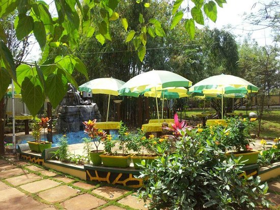 Waterhole family garden restaurant lonavala restaurant for Pool garden restaurant nairobi