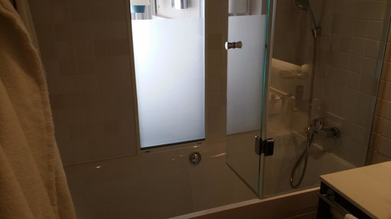 Pullman Cannes Mandelieu Royal Casino : Bath with shower head as well as walk-in shower