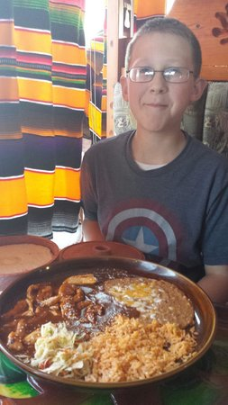 Fiesta Mexicana Family Restaurant: My son with a huge plate of chicken mole!