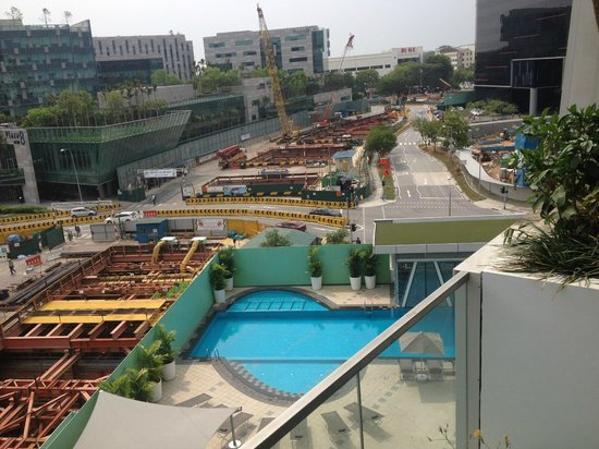 Capri by Fraser Changi City : View of pool and buildingwork
