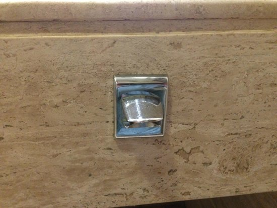 Now Sapphire Riviera Cancun: bottle opener is in the bathroom