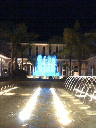 Gran Melia Palacio de Isora Resort & Spa: Water and  Music. Let the light show begin in the main arcade.