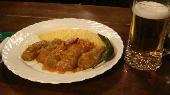 Caru' cu Bere: Polenta, Sour Cream, and Cevapcici wrapped in Cabbage.