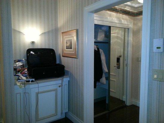 Avalon Hotel: Looking from bedroom towards door.   Minifridge is on left behind door.