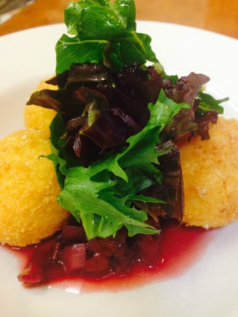 Tre Rosat Cafe : goat cheese stuffed fried polenta on cherry and radish ragout.