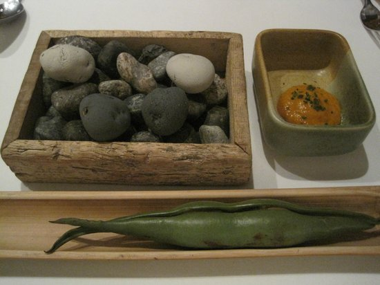 Malabar : Appetizer - little potatoes on a bed on little stones, some sort of pod, and dipping sauce.