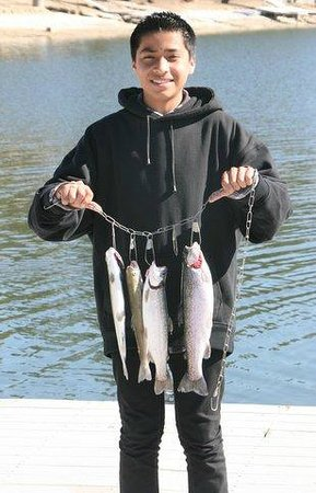 Bass Lake Water Sports Boat Rentals: Happy Young Boy with His Bass Lake Catch! The Pines Resort Bass Lake Ca