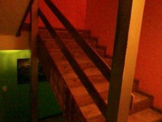 Tangoinn Downtown: Estancia entre el primer piso (comedor, baños y living) y salida para la parrilla en el deck.