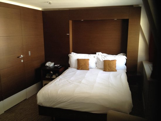 Park Grand London Paddington : Main room - door to left is access to shower room. TV where I am standing.