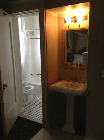 Peery Hotel : Bath area with door fully open against the armoire