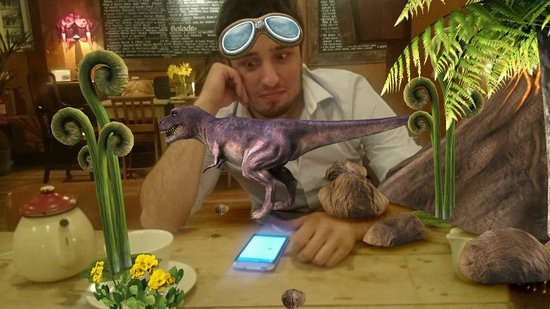 Pinto Lounge: Clearly this place would not allow real dinosaurs. It's just a phone app.