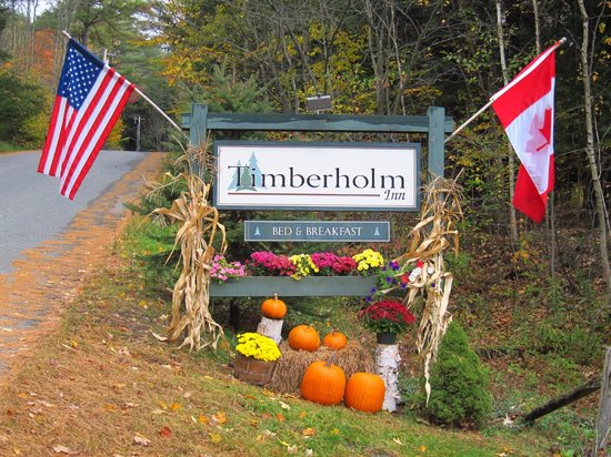 Timberholm Inn Sign by Road