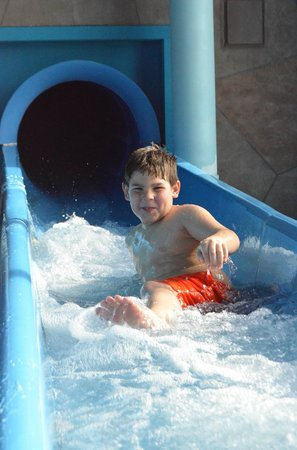 Adam's Mark Hotel & Conference Center : having fun on the slide