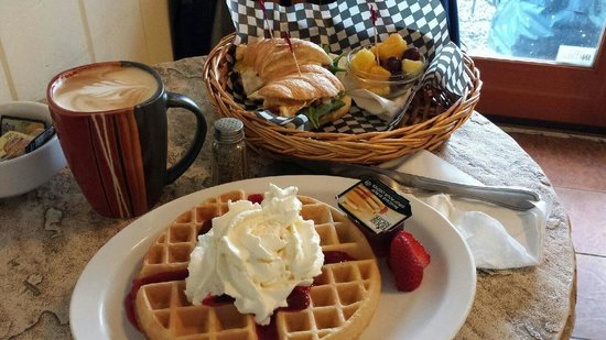 Cafe Vincente: Strawberry belgian waffle and egg/ham breakfast croissant