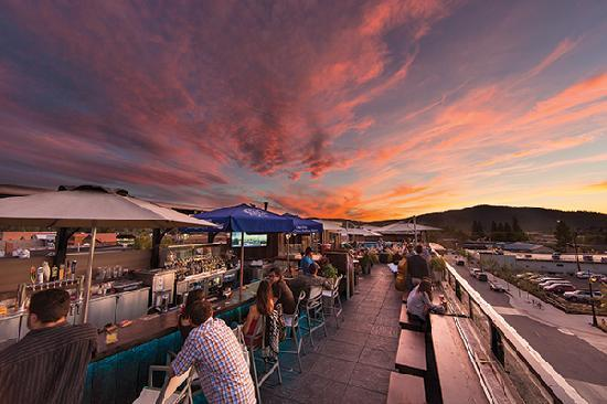 Rooftop drinks at sunset in downtown Whitefish.