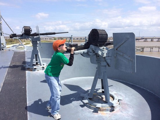 Battleship USS ALABAMA: Oldest son shooting down enemy planes.