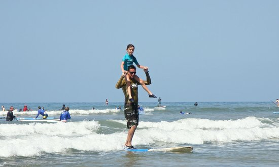 Maui Wave Riders: Josh surfing our daughter in