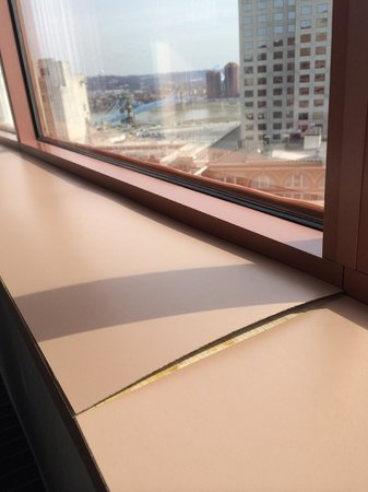 Hyatt Regency Cincinnati: Unrenovated window sill w/warped formica