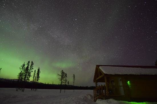 Northern Lights Resort & Spa: The view of the lights and our cabin. note: not a professional photographer - You, too, can capt