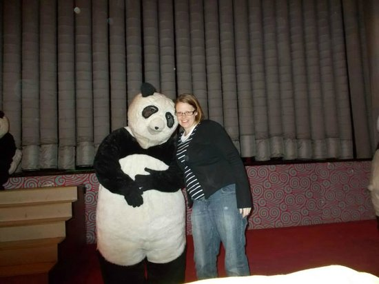 Chaoyang Theater: You're never too old to cuddle a panda.