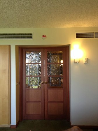 Country Club Tasmania : Entrance to your own Spa Room alongside King Size Bed