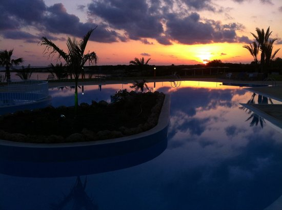 Corallia Beach Hotel Apartments : The pool at sunset
