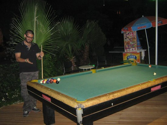 Ant Apart Otel: tanel trying to play pool.