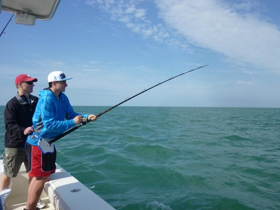 Ms.B.Haven Fishing & Eco Charters : My son & husband attempting to reel in the 9ft shark!