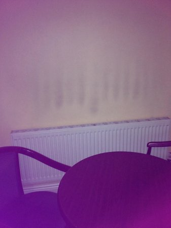 Longford Arms Hotel : Burn stains on the wall from the radiator