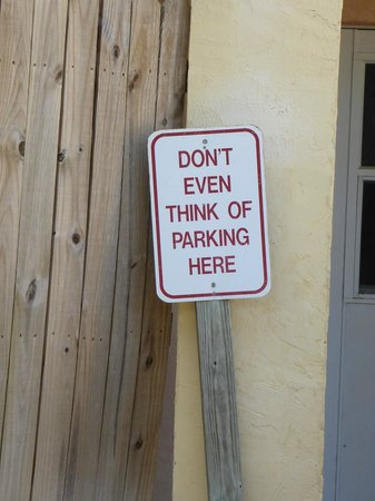 Coconut Cove Resort and Marina: Parking sign outside rooms in main hotel block