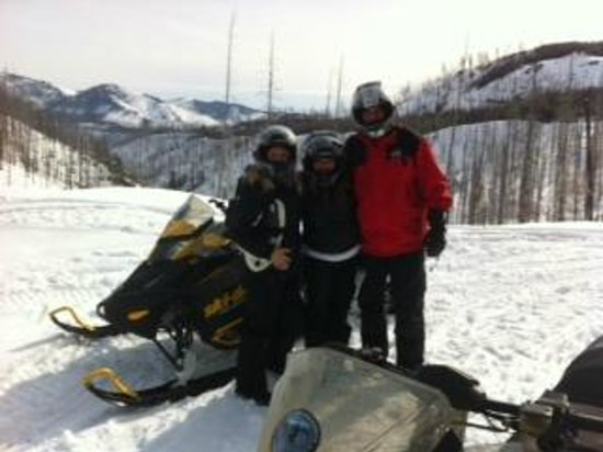 Swan Mountain Snowmobiling: Enjoying the view from the top of the mountain