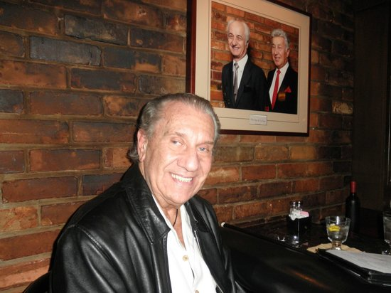 Mr. Paul's Chophouse: picture of mr. paul (deceased) & his brother on the wall