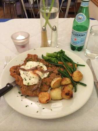 Bon Gusto: Veal Scallopina Holstain, topped with a fried egg and served with roasted potatoes and vegetable